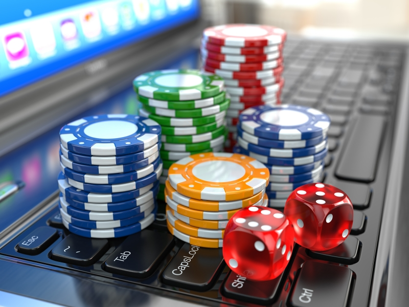 9913921-virtual-casino-online-gambling-laptop-with-dice-and-chips